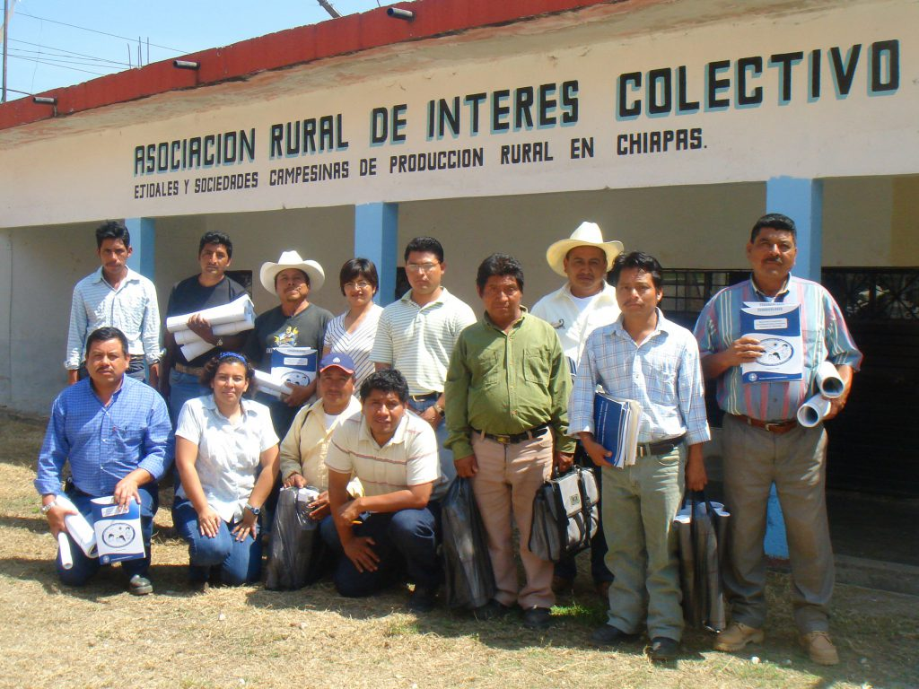 Community Health Workers from Chiapas, Mexico posing in a group with educational materials about tuberculosis