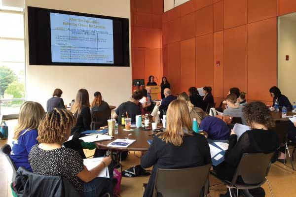 Prospective volunteer clinicians at a training at Adelphi University